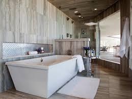 bathroom white tile freestanding bathtub faucet handle towel
