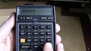 hp 41c scientific calculator with 3 memory modules and an ir