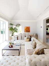 chic tufted couch in family room eclectic with beach condo ideas