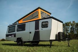 travel trailer with garage taxa outdoors debuts the mantis a lightweight camper that can