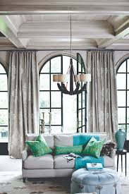 casual yet elegant living room with the cameron chandelier by