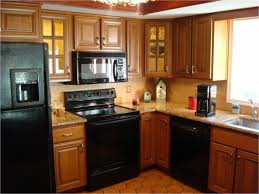 transitional kitchen with freestanding black electric smooth top
