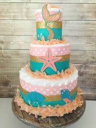 mermaid diaper cake in coral teal and gold mermaid theme baby