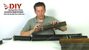 replace spring on garage door how to measure a garage door torsion spring to order replacement