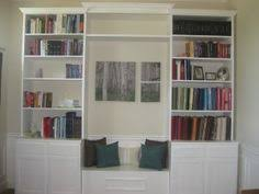 Bookcase Bench 49762d1345862217 Lower Cabinets Upper Bookcases Flanking Window