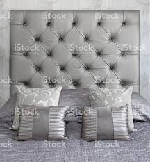 silver coloured silk cushions on a bed stock photo 185277090 istock