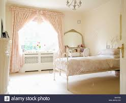 cream and white bedroom pink toile de jouy curtains on window in cream country bedroom