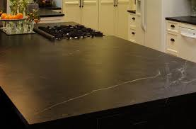 black soapstone countertops with gas range in the kitchen island