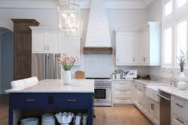 Blue And White Kitchen Cabinets White Pecky Cypress Kitchen Cabinets With Navy Blue Island