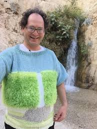 how does it take to knit a sweater makes sweaters of places and then photographs himself in those