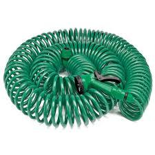 coil garden hose coiled garden hose hanging on faucet against