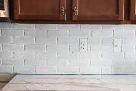 Remodelaholic DIY Whitewashed Faux Brick Backsplash - White brick backsplash