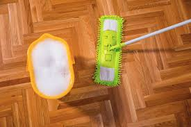 mopping laminate floors with water