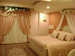 wedding bedroom decoration with flowers and candles bedroom