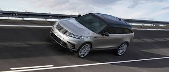 land rover above and beyond logo introducing the range rover velar to the colorado springs market