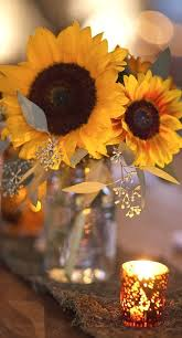 table centerpieces with sunflowers sunflowers love them they were my wedding flowers sunflowers
