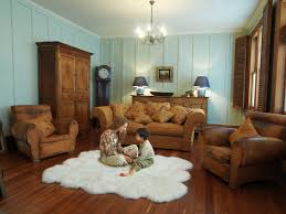 Family Room Design With Brown Leather Sofa Flooring Cozy Sheepskin Rug With Brown Leather Sofa And Fireplace
