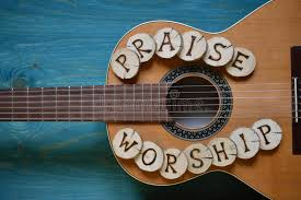 wood words guitar on wood with words praise and worship stock photo image