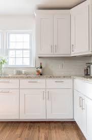 kitchen subway tile backsplash and window treatments with