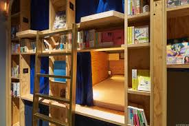 book and bed hostel lets you sleep in the bookshelves