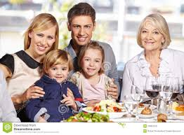 happy family at lunch table stock photos image 34667043