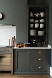 grey kitchen cabinets with granite countertops wooden varnished floor grey kitchen storages with gas ranges