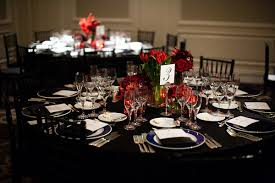 reception seating black tablecloth dark blue and white dinner