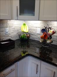 kitchen grey subway tile backsplash with dark cabinets gray