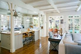 open plan white kitchen into hearth room living space