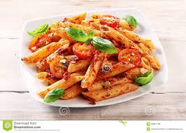 gourmet tasty italian penne pasta on a plate stock photo image