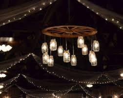 wagon wheel light fixture wheel chandelier etsy