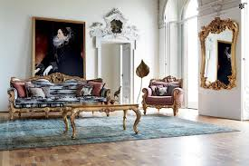modern victorian style living room with gold framed sofa with