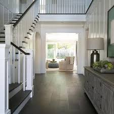 foyer with full wall board and batten transitional entrance