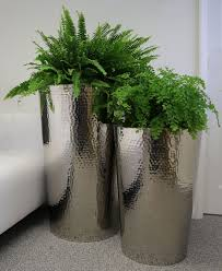 hammered stainless steel tapered round planters from primero pots