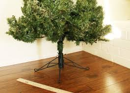 hide your tree base with a gift a bigger