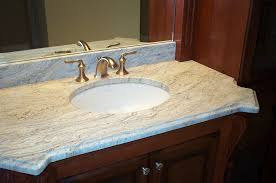 bathroom cozy countertop design with giallo ornamental granite