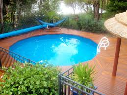 swimming pool hammock with iron case on wooden deck with