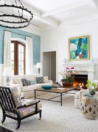 beige couch blue wall play with scale floor rug high