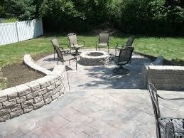 Backyard Cement Patio Ideas by Stamped Concrete Patio With Retaining Walls And Fire Pit In