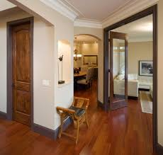 brown baseboards entry traditional with arched doorway white