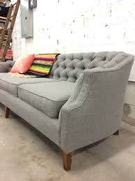 before u0026 after vintage tufted sofa goes from skirted to stunning