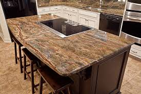 granite islands kitchen flat top with seating area and gentle curve to up the