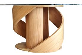 incantation spiral dining table curving wood and glass