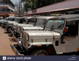 kerala jeep fleet of private mahindra willys jeep silver taxis outside temple