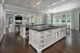 floating kitchen islands two kitchen islands with black marble countertops transitional