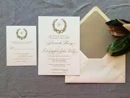 monogram wedding invitations magnolia wreath and monogram wedding invitation in gold ink
