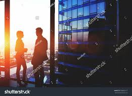silhouette two successful managing directors discuss stock photo