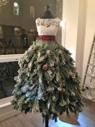 she attaches tree branches to the dress form what it becomes