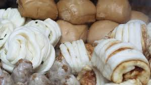 freshly cooked steamed buns and dumplings for sale in a small