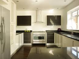 contemporary white kitchen with black star galaxy granite worktops